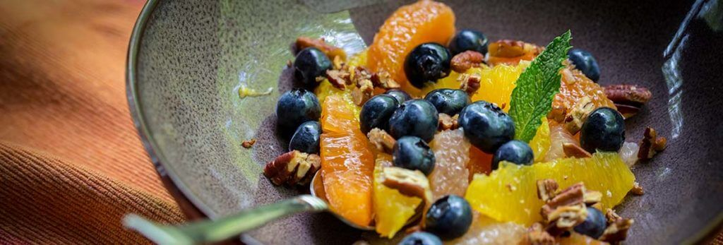 bowl of fresh fruit and nuts