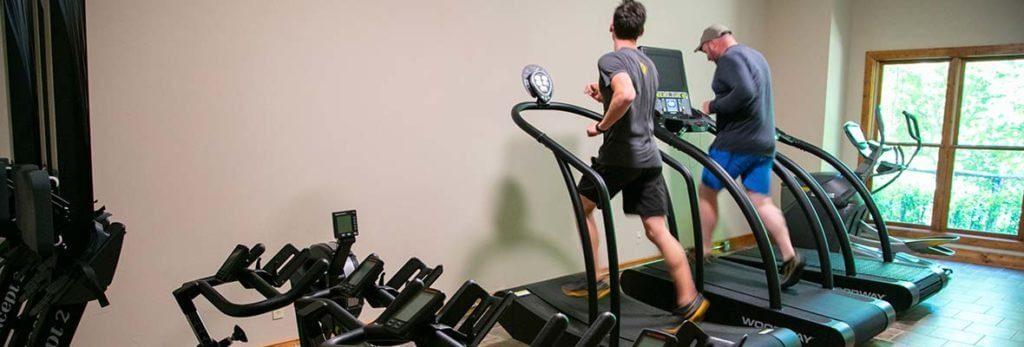 men running on woodway treadmills