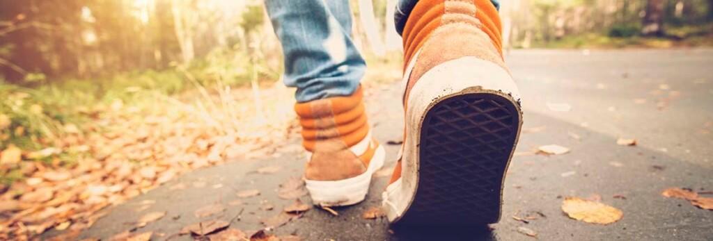 orange sneakers of someone walking away